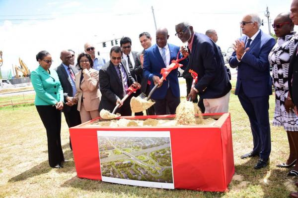 Prime Minister Dr the Hon. Keith Rowley, Minister of Works and Transport, Hon. Rohan Sinanan and NIDCO CEO Herbert George turn the sod at the official ceremony for the Curepe Interchange project.