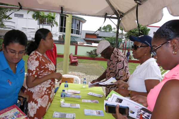 Staff of the Ministry interact with participants of the Autism Awareness Event at Monte Cristo Park, Sangre Grande