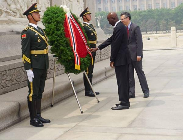 Prime Minister Rowley lays a wreath at the Monument to the People's Heroes in Beijing