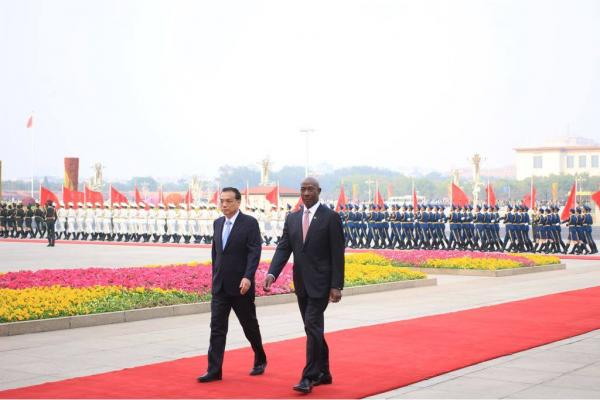 Prime Minister Rowley and His Excellency Li Keqiang during the inspection of the Guard of Honour